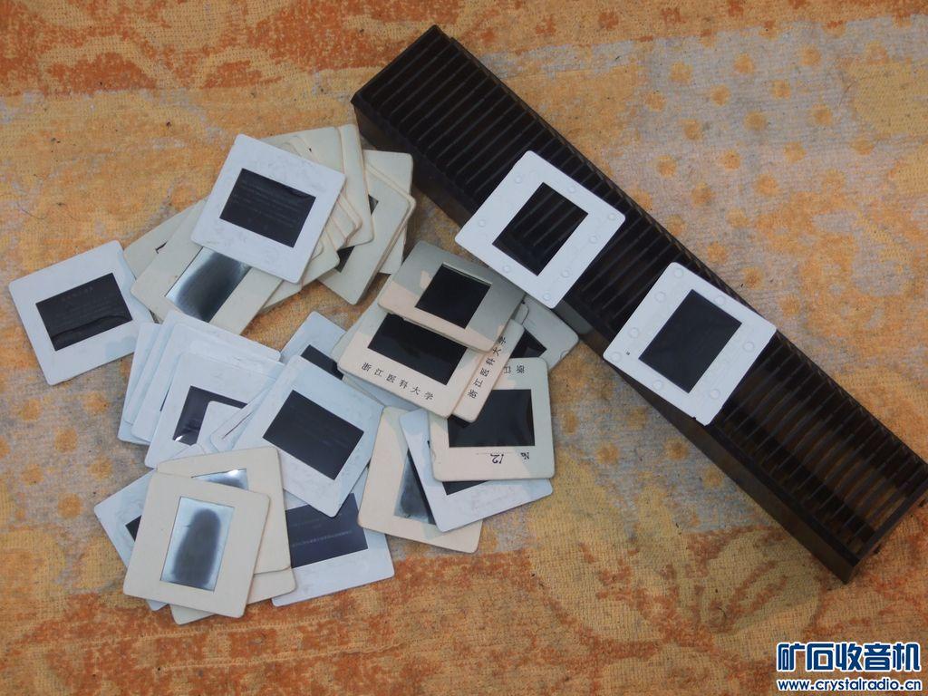 幻灯片 气压表 电容 投影机 监控头 电子天平 光学玻璃片 杂物一堆